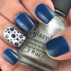 Turn a serious manicure into a fun one with this blue and silver nail design.
