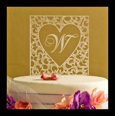 Wedding Cake Topper Custom Wedding decorations Engraved Monogram with engraved heart. $13.95, via Etsy.
