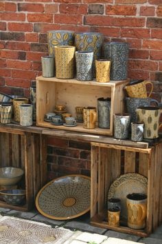 This image link leads to an annual mid-summer ceramics event in England called Earth and Fire. Go to past events and it has previous years' artists and their websites to see their work.