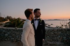 Two handsome grooms travel along with their closest friends and family all the way to their favorite holiday destination in Mykonos to exchange vows under the Aegean sky Play Hard To Get, Moving In Together, Make You Believe, Everything Is Possible, Crystal Clear Water, First Dates, White Ribbon, Mykonos, Holiday Destinations