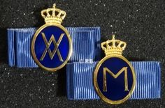 Badge for the Grand Master of the Household of King Willem-Alexander ; Badge for the Grand Mistress of the Household of Queen Maxima