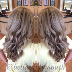 Ash blonde highlights with chocolate brown lowlights on long wavy hair. Bella Vi Salon in Plymouth Mi.