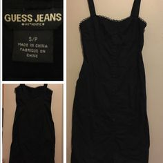 Black Guess Dress Just below Knee length on me and I am 5'4. Buttons all the way down the front for decoration only, zipper on side Dresses Midi