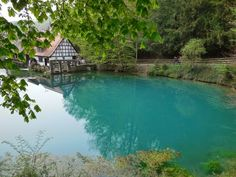 The Blautopf spring:  This second largest spring in Germany, a 69 ft. deep pond of turquoise-blue water, forms the Blau river.