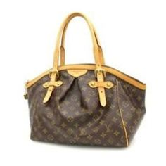 8b293cef9fbf This Louis Vuitton Tivoli is pre loved in great condition.  Vuitton  Louis  Vuitton