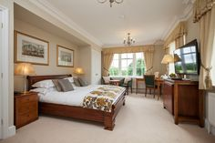 Luxury bedroom at Goldsborough Hall. Image by Peter Boyd Photography