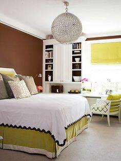 Why It Works   -- The small punches of lime in the bed skirt, window treatment, and pillows give this room a sophisticated look. Just a few dashes of color can make a big statement.  -- To tie in the chocolate walls, a simple trim was added to the white duvet.