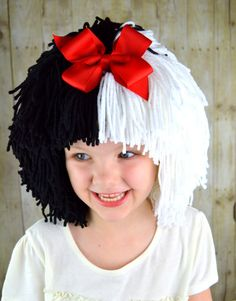Cruella Deville inspired wig for your Halloween Costume! • Handmade with 100% acrylic yarn • Removable bow • Bouffant Style with bangs • Stays on without pins, bands or glue • Warm and comfortable • D