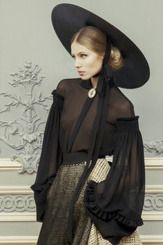Needlepoint, raw silk edges, elegant straw hats and enough sex appeal to supply a lifetime. That basically sums up the amazing collection by Ulyana Sergeenko. Part of the Russian Fashion P…