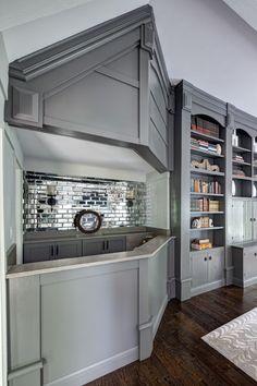 Buckingham Interiors - dens/libraries/offices - bar, home bar, home bar ideas, gray cabinets, gray bar cabinets, mirrored backsplash, mirror...