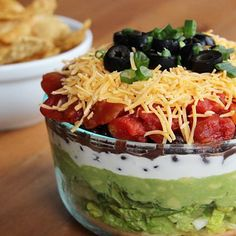 Smarter Snack Time: Lightened-Up 7-Layer Dip 2 cups chopped romaine lettuce 2 avocados 1 cup greek yogurt 2/3 cup black beans 1/2 cup diced tomatoes 1/2 cup shredded cheese sliced black olives and scallions