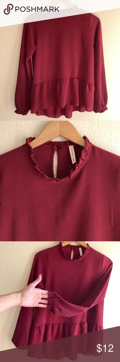 Chic maroon peplum poet blouse Chic maroon poet blouse with peplum detail by Orange Creek (Boutique Brand). Ruffled at the neckline and at the end of the sleeves. Looks chic with cropped skinny pants and booties or dress down with jeans!    ***If you have ANY questions at all - measurements, fabrication, item condition, etc. - PLEASE ASK 👍 It's important to me, that you, as the customer, are 100% clear about the product you are purchasing. Happy to answer ANY questions big or small! Tops…