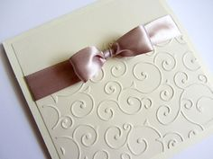 Ivory Wedding Invitations  Customize these unique invitations during the ordering process with your own colors and wording.  Double layered invitation  Double folded Embossed Double tied...