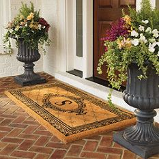 Planted urns by front door makes a grand entrance