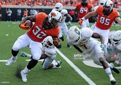 News Photo : Running back Chris Carson of the Oklahoma State...