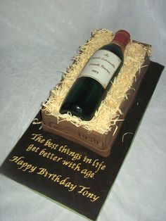 Wine birthday cake - Wine bottle cake for a good friend who turned 50. It was a really fun cake to do. I loosely followed the instructions in the Confetti Cakes book. Cake itself was walnut coffee cake filled with an espresso buttercream, cake is covered in fondant. The straw is gum paste cut with a pizza wheel, the label is gum paste which is hand painted.