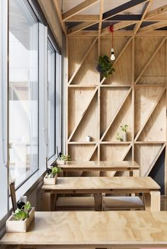 No-frills plywood tables (and shelving) in Melbourne. SeeJury: A Cafe in a Converted Prison.