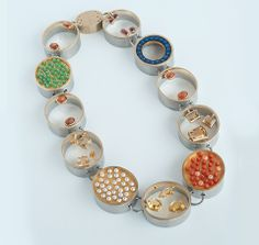 "ANNA HEINDL, ""SCHATZ"" NECKLACE 2011. GOLD, GOLD-PLATED SILVER, STAINLESS STEEL, CORAL, PEARLS, VARIOUS GEMSTONES."