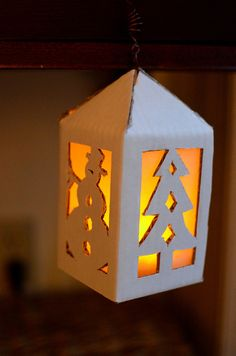 cardboard lantern how to. We should do this for center pieces w/ boy scout cut outs. :)