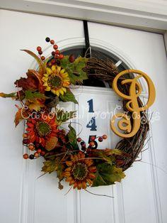 Monogram Sunflower Fall Wreath Sunflower Wreath, Personalized Fall Grapevine Wreath. $64.95, via Etsy.