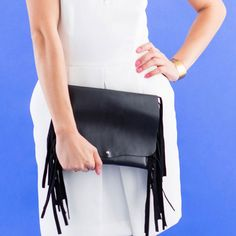 LOVE this fringed clutch.