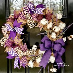 This wreath features beautiful white cotton bolls, ribbons, and accent flowers. The wreath is approximately 22 inches across. You can choose in the drop down menu if you want purple or blue/turquoise. Due to ribbon variations being out of stock from time to time, the wreath you receive may have a slightly different style of ribbons than those pictured, however the overall look and style will remain very close. Same with floral accents. Message me with any special requests for colors! Tha...