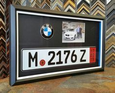 BMW Shadowbox with black frame, white fillet, blue walls of frame, and black leather mat. Shadowboxes don't have to always be antiques.