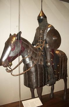"""Persian mail and plate armor for horse and cavalry soldier, dating from 1450, this type of armor became the standard type of equipment for the heavy cavalry under the Timurids (1370-1506), the Mongol successor empire which ruled from Samarkand, and under the Ottoman Turks. These cavalry, armed with bow, sword and sometimes lance, were the main component of all medieval Islamic armies. the New York Metropolitan Museum of Art."""