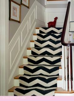 I am definitely thinking about doing this on our stairs.  West Elm has a chevron runner that looks just like this one!