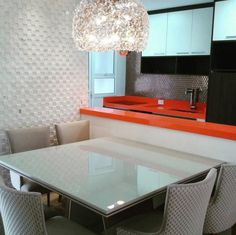 Ever thought of extending your Silestone countertops onto a kitchen table? That's just what this fun and contemporary kitchen design by Silvana Borzi Design features http://www.CabinetsAndDesigns.net/Products/Silestone/