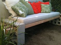 """12 cinder blocks, four 4"""" x 4"""" x 10' posts, cement glue, a cushion and some pillows.  Easy, functional, inexpensive.  Would like bright colors for the cushion and pillows and might even paint the blocks and posts.  I see a project!"""