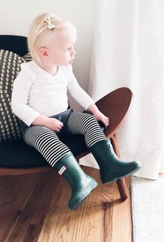 Rainy day outfit simple sleek and stylish. Little blondie baby girl in her galoshes, ready to roll in her thermal leggings from Noble Carriage's Goat-Milk collection. Organic cotton keeps her delicate skin safe and healthy, and makes a sustainable outfit choice. Little hipster minimalist saving the world.