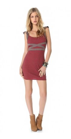 CROSS MY HEART DRESS $37.30 SPECIAL $34.30 YOU SAVE: 8% Jersey trim wraps the bodice of this Free People dress, accenting the figure-hugging silhouette. Back cutouts add a sexy peak of skin. Lined.