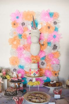 Fun backdrop and dessert table at a unicorn baby shower party! See more party planning ideas at CatchMyParty.com!