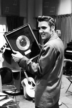 """Making history: One of Elvis Presley's first record was """"Heartbreak Hotel"""" which topped the charts in 1956."""