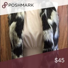 """Carmin fur vest Brown and beige fur vest. Measurements are 25"""" from the neck to the bottom hem. Medium size can fit a Bust size 35"""" and waist 27"""" carmin Other"""
