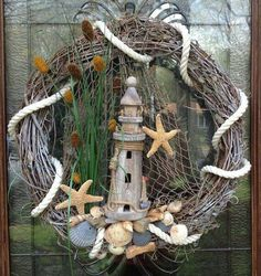 Your place to buy and sell all things handmade : Nautical Lighthouse wreath by BCCbyBecca on Etsy Nautical Wreath, Seashell Wreath, Seashell Art, Seashell Crafts, Coastal Wreath, Nautical Theme, Wreath Crafts, Diy Wreath, Grapevine Wreath