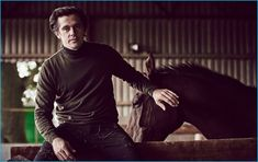 Posing with a horse, Werner Schreyer wears a cashmere turtleneck, sweater, and slim-fit denim jeans from Ralph Lauren Purple Label.