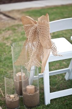 Fill our cylindrical vases with sand and candles for easy destination wedding path lighting or as seen here at a rustic wedding. Our full vases collection is here: http://www.lightsforalloccasions.com/c-411-vases-vase-filler.aspx