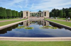 American soldiers grave yard in france | Omaha Beach Memorial at the American Cemetery in Normandy, France ...