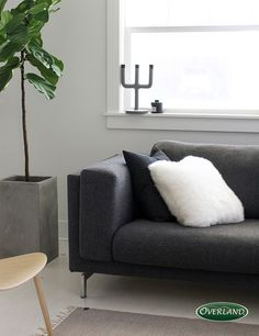 Sheepskin isn't just for rugs! It adds an unexpected touch of cozy to a modern style couch.