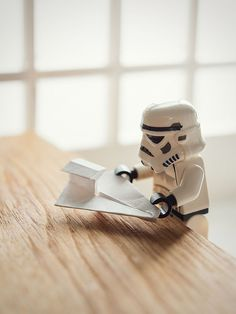 Stormtrooper making an Origami Spaceship, Legos.