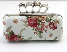 Love this chic white canvas clutch with red beige and green floral prints. Don't miss the four knuckle ring clutch with stone and metallic designs | Indian Wedding Accessories | Wedding Clutches | Designer clutches | Credits: Tommorowtomarry.com | Every Indian bride's Fav. Wedding E-magazine to read. Here for any marriage advice you need | www.wittyvows.com shares things no one tells brides, covers real weddings, ideas, inspirations, design trends and the right vendors, candid photographers…