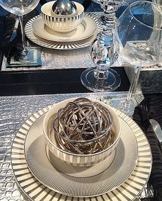 Tasteful table: @justmemyselfandi002 snapped a photo of our luxe Luna Dinnerware, Everglades Placemat, Slant Stemware, and Nest Sphere. Click to shop tableware.