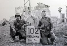 Alex Lambros, right, poses for a photo with a fellow member of the 34th Infantry Division just after their unit captured Bologna, Italy.
