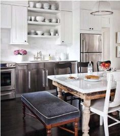 Unexpected seating combination that brings so much charm to this already charming kitchen :)