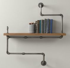 industrial pipe shelf, restoration hardware baby.... oh my god Im in love... this is so cool... argh I love it