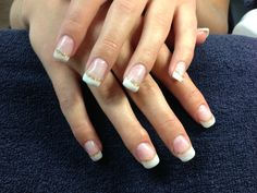 Laurel's nails. Simple French white tips with a gold glitter smile line.