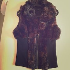 NWT Faux fur rubbed vest jacket Faux fur vest jacket, size L. Beautiful brown and black raccoon fur imitation jacket. Brand new never worn. Ribbed, very slimming. Will fit sizes 8-12 Ashley Stewart Jackets & Coats Vests