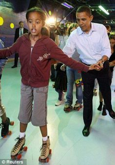 President Barack Obama With Malia Obama...
